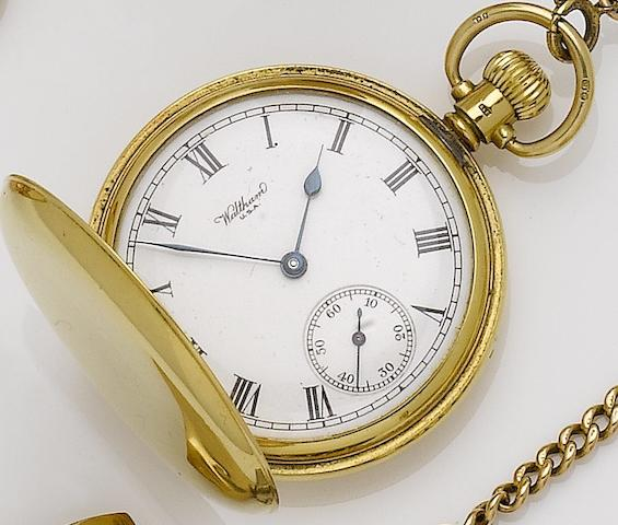 Waltham. An 18ct gold keyless wind full hunter pocket watch with chain, matchstick case and coin holder No.596441, Birmingham Hallmark for 1935