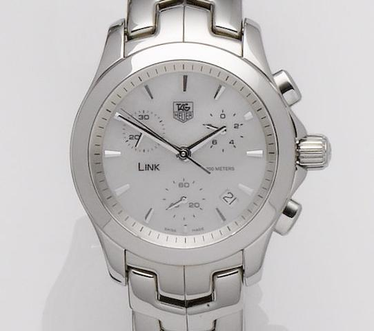 Tag Heuer. A stainless steel and mother of pearl quartz chronograph calendar bracelet watch Link, Sold on May 13th 2009