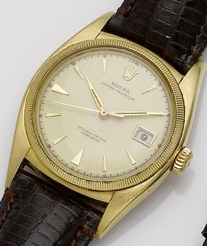 Rolex. An 18ct gold automatic calendar centre seconds wristwatch Oyster perpetual, Ref: 6075, Case No. 685070, Movement No. 48052, date??