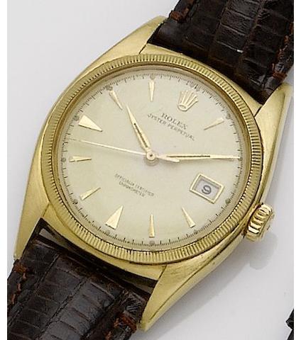 Rolex. An 18ct gold automatic calendar centre seconds wristwatchOyster perpetual, Ref:6075, Case No.685070, Movement No.48051, Circa 1945