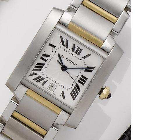 Cartier. A stainless steel and gold automatic calendar bracelet watch Tank Francaise, Recent