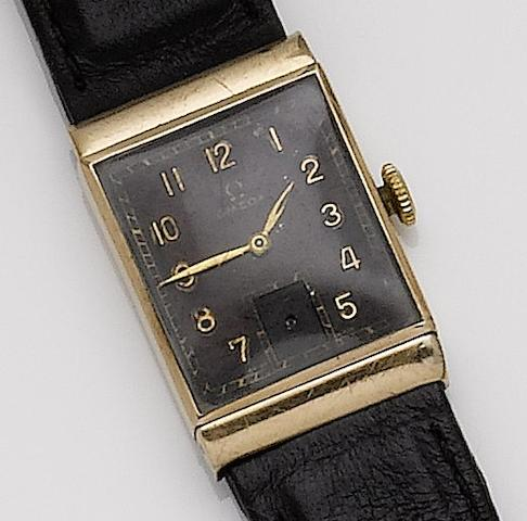 Omega. A 9ct gold manual wind wristwatch with black dial1940's