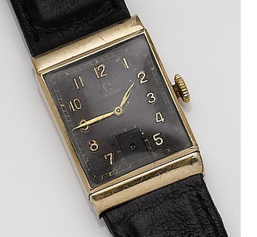 Omega. A 9ct gold manual wind wristwatch with black dial 1940's