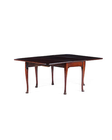 An Irish George II mahogany gate-leg dining table