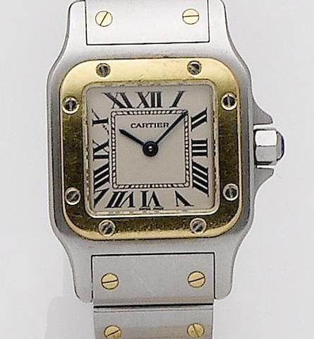 Cartier. A lady's stainless steel and gold quartz bracelet watchSantos, Recent