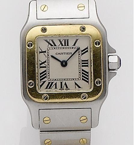 Cartier. A lady's stainless steel and gold quartz bralcet watch Santos, Recent
