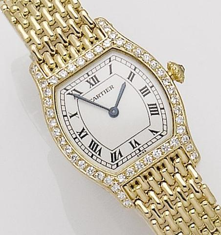 Cartier. A lady's 18ct gold and diamond set manual wind bracelet watchTortue, Recent
