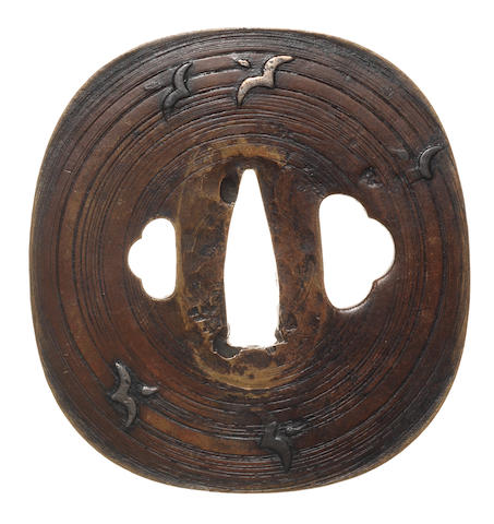 A copper tsuba Attributed to Hirata Hikozo I, 17th century