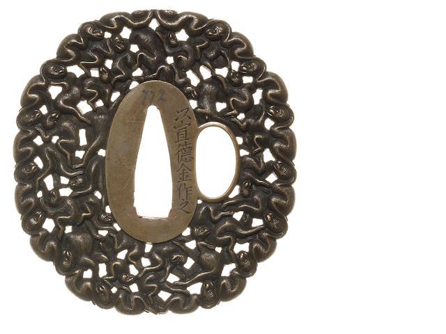 A brass tsuba Hizen School, early 19th century