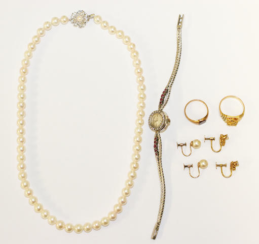 "A small collection of jewellery, comprising a ruby and diamond cocktail watch, a pair of diamond set gold ""nugget"" earrings and ""gold nugget"" ring, a single row cultured pearl necklace, a pair of cultured pearl earrings and a signet ring."