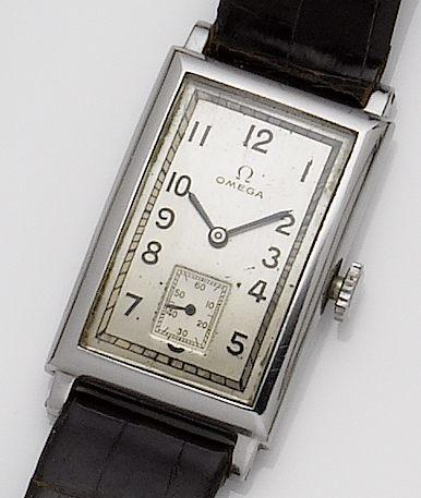 Omega. A stainless steel manual wind rectanglar wristwatch together with with Omega penknife Circa 1940