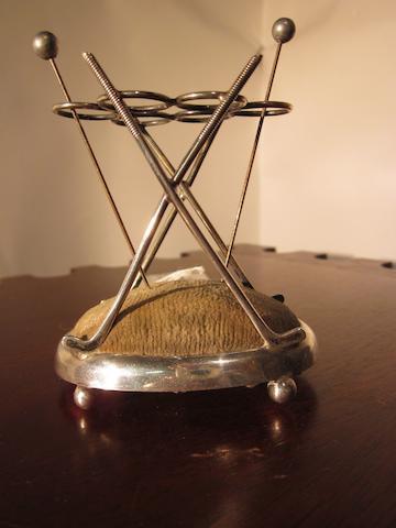 A silver Walker & Hall golf themed pincushion