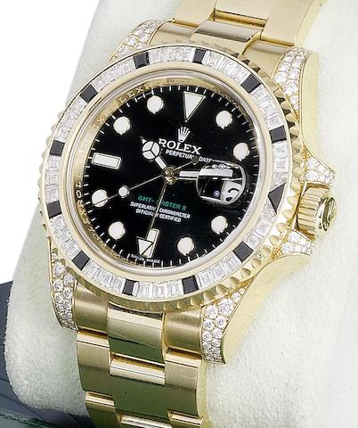 Rolex. An 18ct gold, diamaond and sapphire set bracelet watch together with fitted box and papers GMT Master, Ref 116758, Serial No. Z749498, Sold 12th December 2007