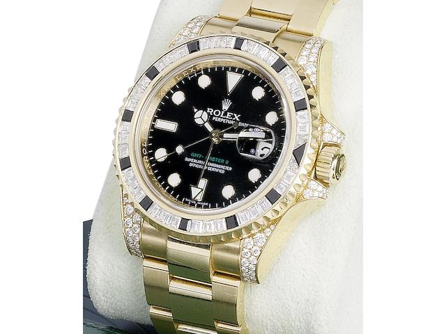 Rolex. An 18ct gold, diamond and sapphire set bracelet watch together with fitted box and papersGMT Master, Ref:116758, Serial No.Z749498, Sold 12th December 2007