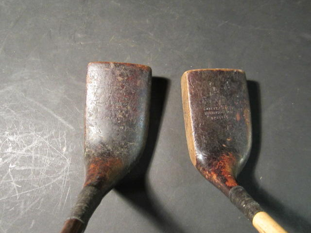 Two Gassiat style wooden headed putters