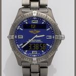 Breitling. A titanium digital and analog display chronograph quartz bracelet watch with second time zone, alarm and minute repeating function Ref:E65062, Case No.8865, Sold May 8th 1998