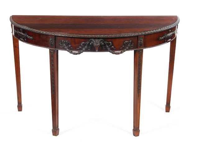 A George III-style carved mahogany demi-lune side table, in the Neo-Classical manner of Robert Adam Late 19th/early 20th Century