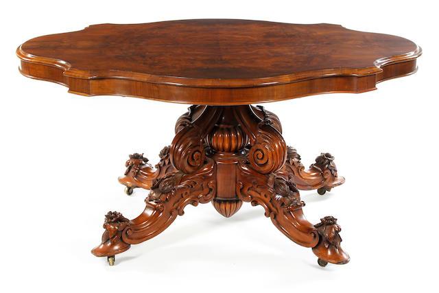A mid-Victorian walnut and figured walnut tilt-top breakfast table