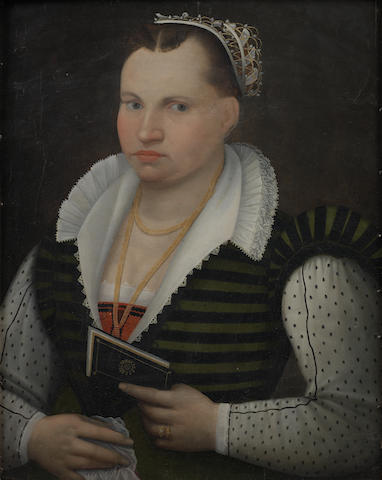 Follower of Alessandro di Cristofano Allori (Florence 1535-1607) Portrait of a lady, bust-length, in a striped black and green dress and a white chemise,
