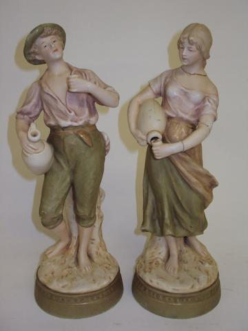 A pair of Royal Dux figures