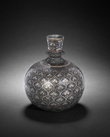 A Mughal silver and brass inlaid alloy Bidri Huqqa Base  Bidar, Deccan, 17th Century