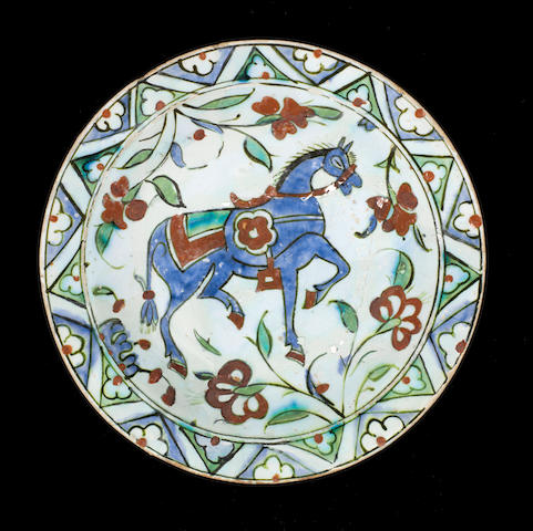 An Iznik dish with horse