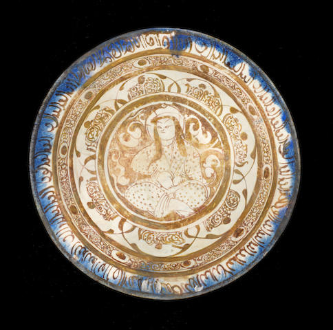 A large Kashan figural lustre pottery dish Persia, 13th Century