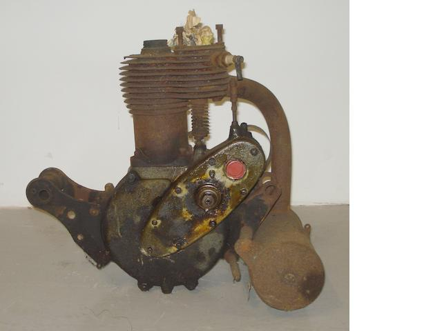 An unidentified single cylinder side-valve motorcycle engine,