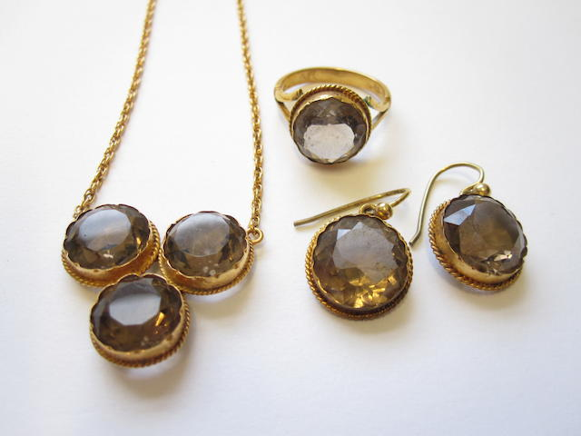 A smoky quartz pendant, ring and earring suite