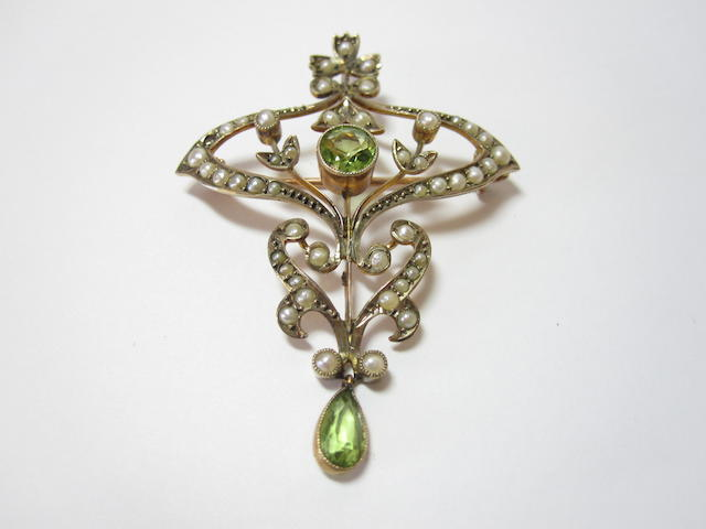 A peridot and seed pearl brooch/pendant,