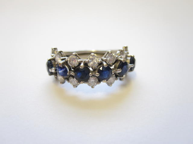 A sapphire and diamond half eternity ring