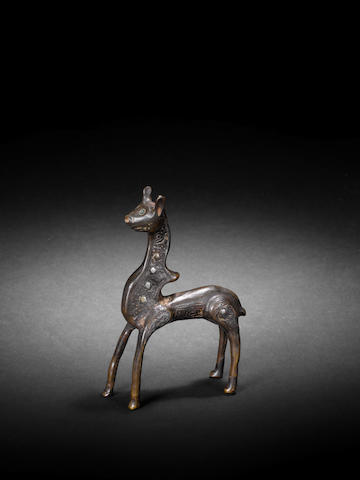 A Seljuk silver-inlaid engraved bronze Figurine of a Deer Persia, 12th Century