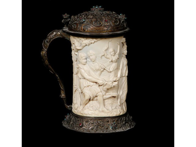 A 19th century ivory and gilt metal tankard
