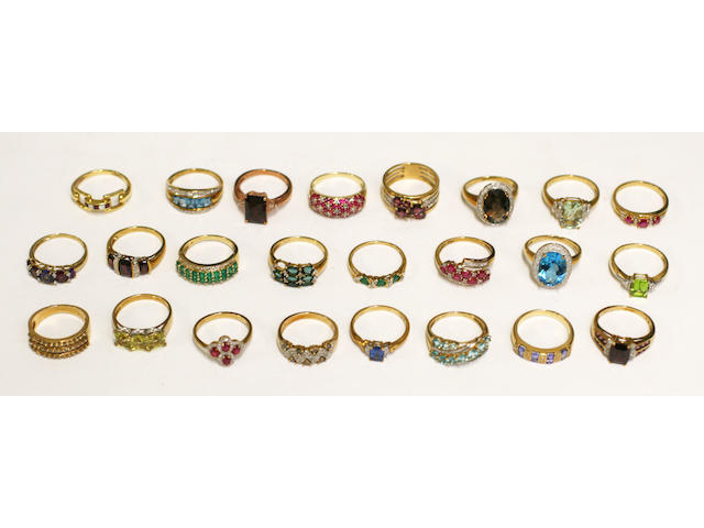 A collection of 24 yellow precious metal diamond and gem set rings, (24)