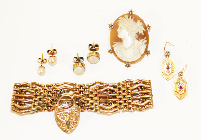 A small collection of jewellery, comprising a Victorian gate-link bracelet, to scroll engraved heart-shaped padlock clasp, stamped '9c', a shell cameo brooch in seed pearl set mount, a pair of Victorian ruby and diamond set earpendants, a pair of cultured pearl earstuds and a pair of round cabochon opal earstuds.