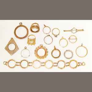 A collection of assorted empty mounts for coin jewellery