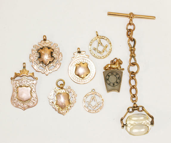 A small collection of gold fobs,