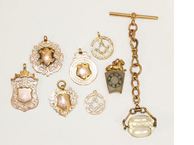 A small collection of gold fobs