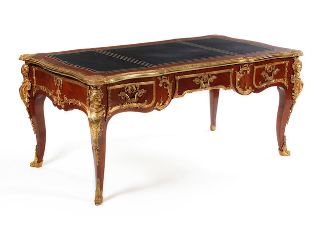 A Louis XV-style kingwood and gilt metal-mounted serpentine bureau plat Late 20th century