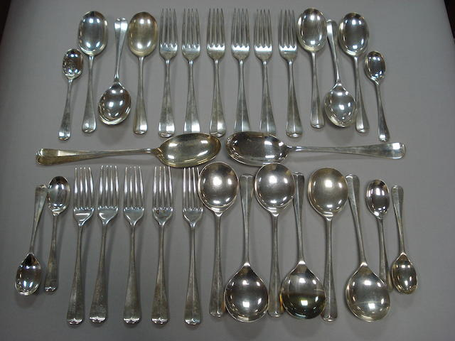 Twelve modern silver soup spoons of rat tail pattern
