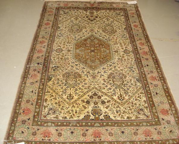 A silk Ghom rug
