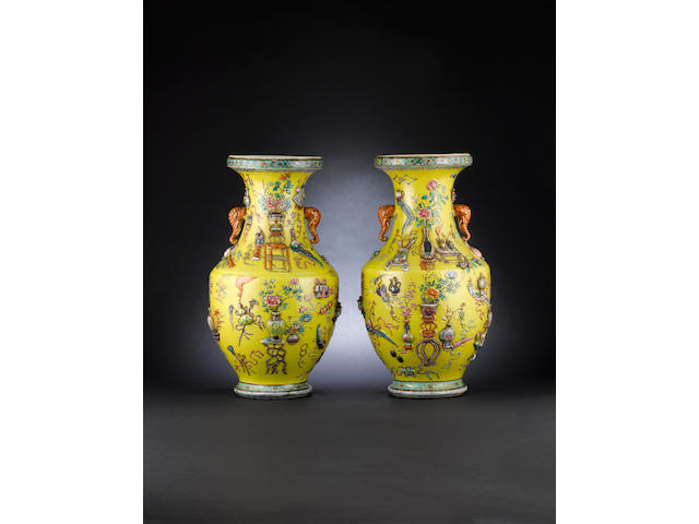 A pair of yellow-ground, pear-shaped vases 19th/20th century