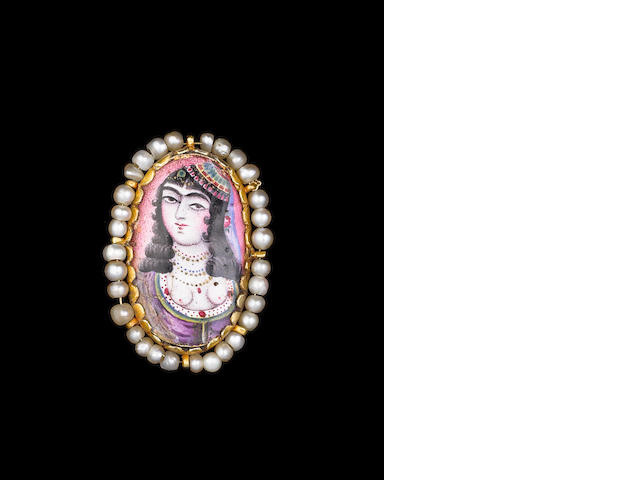 A Qajar enamelled gold Medallion in the form of a Brooch Persia, 19th Century