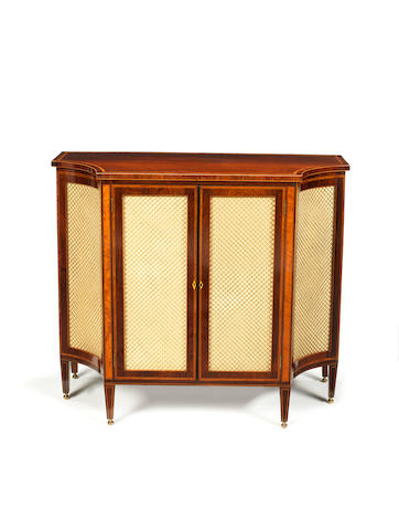 A late George III rosewood and satinwood banded concave sided breakfront side cabinet in the Sheraton style