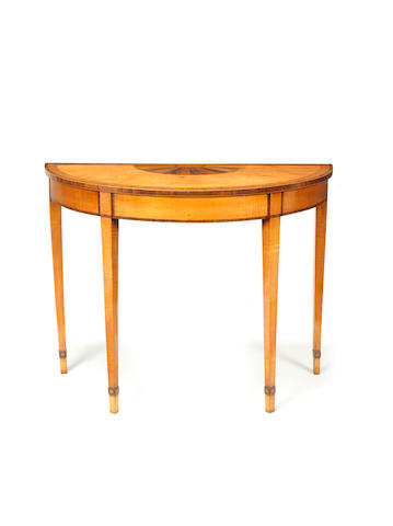 A George III satinwood, sycamore, rosewod and mahogany marquetry demi-lune pier table  in the manner of William Moore of Dublin