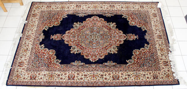 An Indian carpet of Tabriz design, 283cm x 188cm