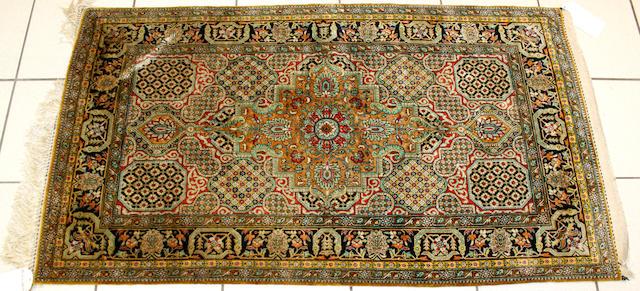 A Ghom silk rug Central Persia, 145cm x 82cm