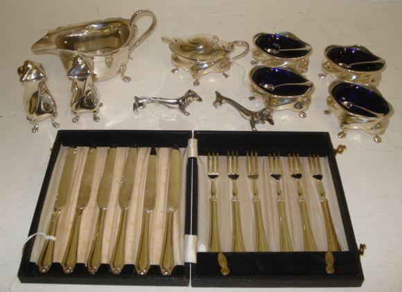 An Art Nouveau silver seven piece condiment set
