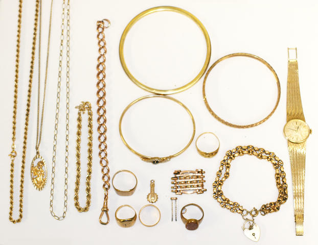 A collection of yellow precious metal jewellery and a rolled gold bangle,