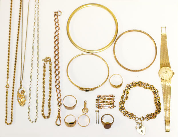 A collection of yellow precious metal jewellery and a rolled gold bangle